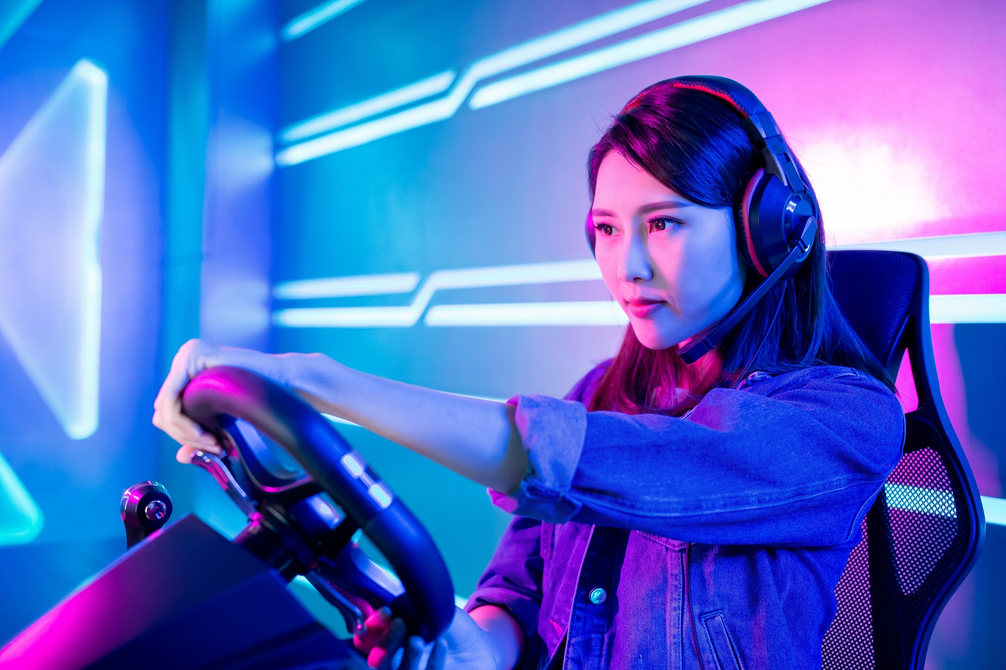 Young Asian Pro Gamer Girl Play Car Racing Online Video Game